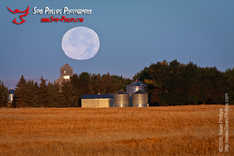 The Harvest Moon setting over a Granary