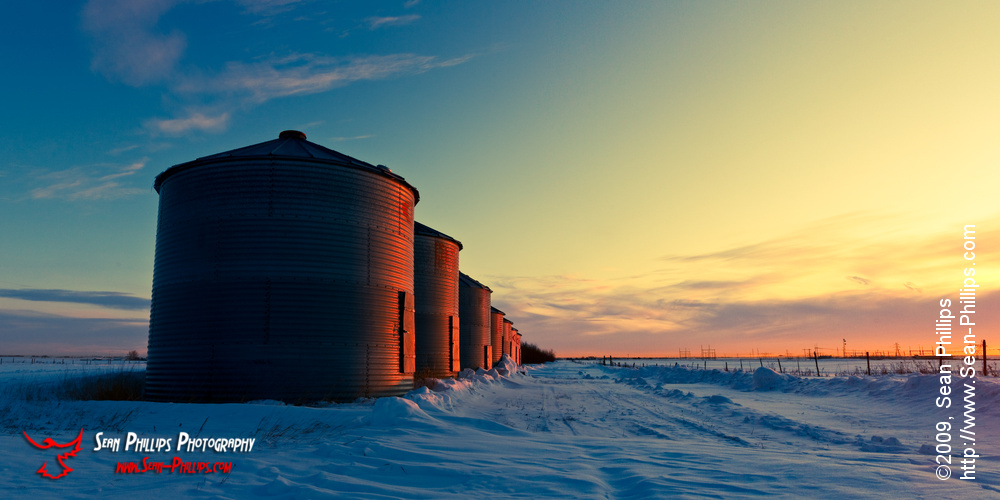 Panoramic image of Grain Bins in the Morning Glow