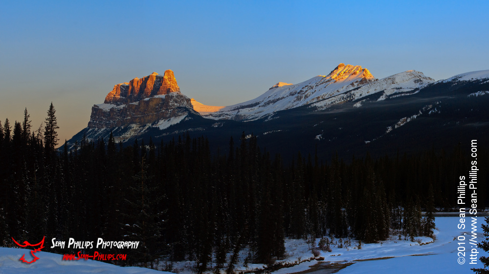 Panoramic image of the Alpenglow on Castle Mountain