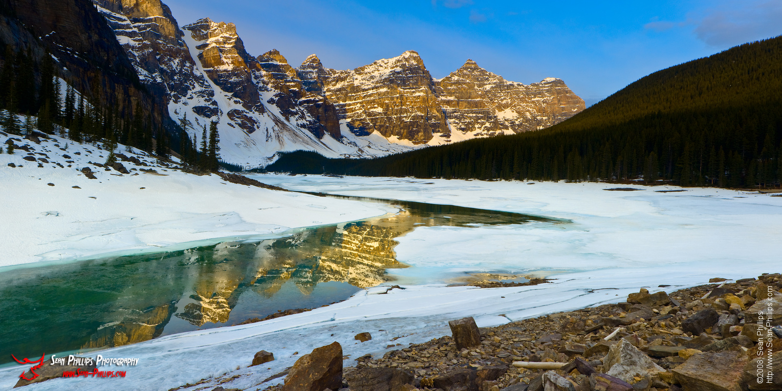 Panoramic Image of Reflections on Moraine Lake at Sunrise