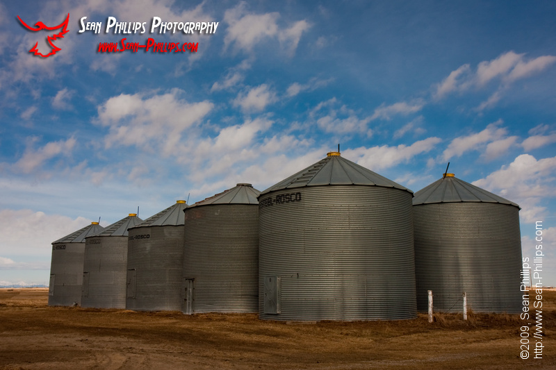 Grain Bins and a Blue Sky