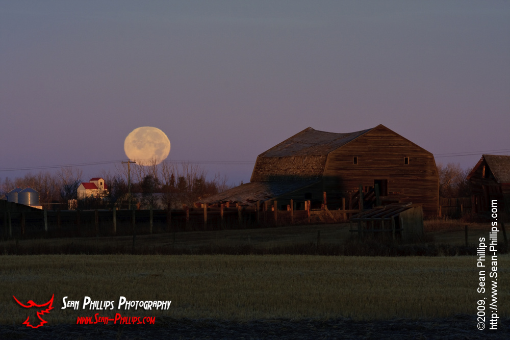 Harvest Moon over a Vintage Farm
