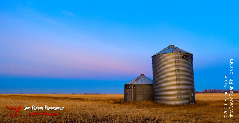 Grain Bins at Sunset