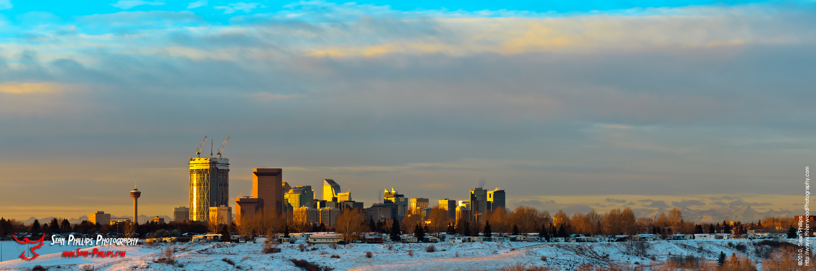 Dramatic skies over the Calgary cityscape in the morning. Including the new Bow building towering over the buildings around it...©2010, Sean Phillips.http://www.RiverwoodPhotography.com (Sean Phillips)